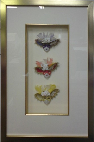 3 Small Masks Framed with a gold frame